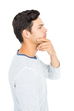 hand on the chin: Man with hand on chin on white background