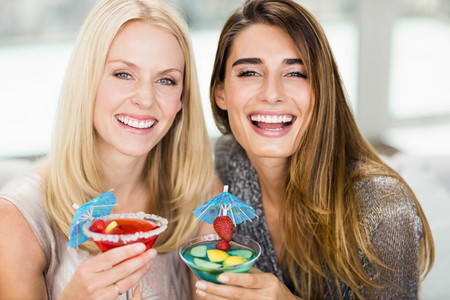 mocktail: Portrait of beautiful women smiling and having mocktail