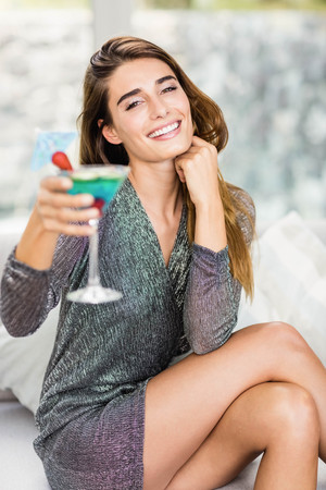 mocktail: Portrait of beautiful woman smiling and having mocktail