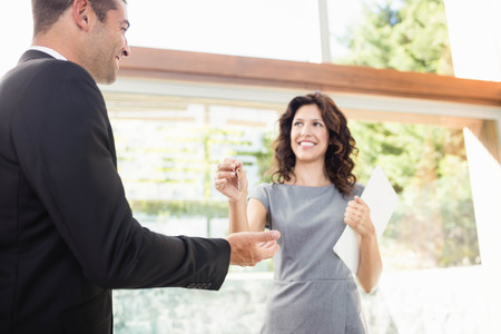 realestate: Real-estate agent giving keys to new property owners Stock Photo