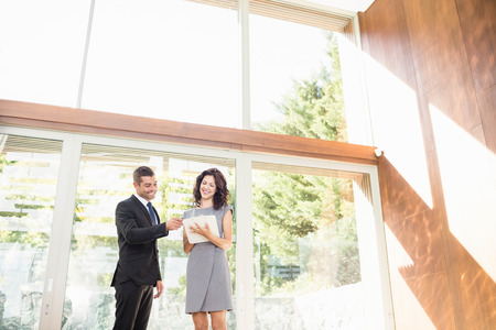 realestate: Real-estate agent interacting with young woman showing new home
