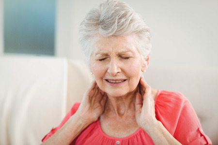 woman close up: Senior woman suffering from neck pain at home