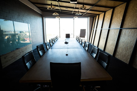 An empty modern conference room and conference table in office Stock Photo