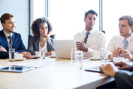 Businesspeople in conference room during a meeting in office Stock Photo