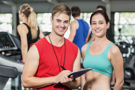 adult  body writing: Male trainer discussing about performance in crossfit gym