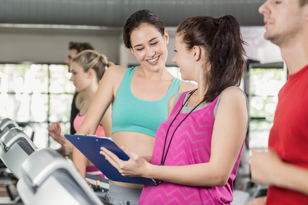 adult  body writing: Female trainer discussing about performance at crossfit gym Stock Photo