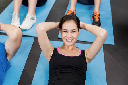 Group of people working their abs in gym Stock Photo