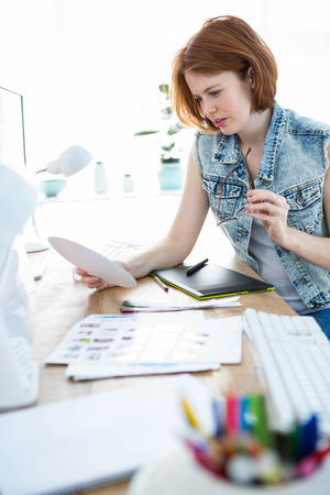 colour chart: focused hipster businesswoman working with a colour chart at her desk Stock Photo