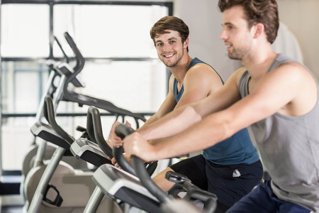 fit people: Fit people doing exercise bike at gym