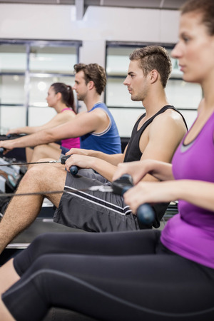fit people: Fit people on drawing machine at gym