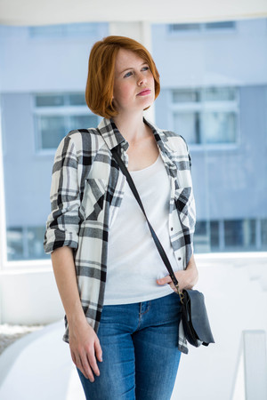 day dreaming: Fashion hipster day dreaming in front of a window Stock Photo