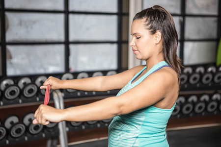 resistance: woman exercising with resistance band in the gym