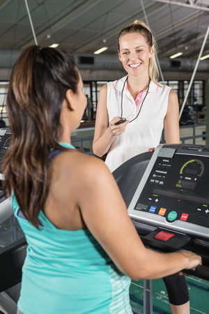 Trainer using stopwatch at the gym Stock Photo