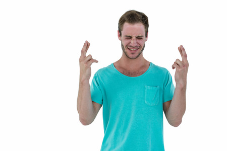 fingers crossed: Hipster with fingers crossed on white background