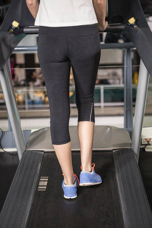lower section view: woman exercising on a treadmill in a gym Stock Photo