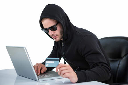 thievery: Man in black hoodie doing online shopping on white background Stock Photo