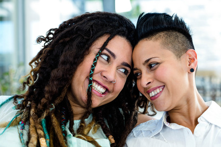 each other: Close-up of lesbian couple looking at each other and smiling