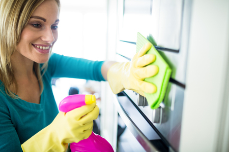 scrubbing up: Pretty woman doing her house chores at home
