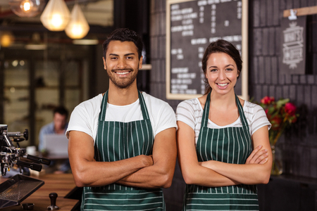 baristas: Smiling baristas standing with arms crossed and looking at the camera