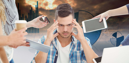 tensed: Tensed businessman with head in hand  against blue data Stock Photo