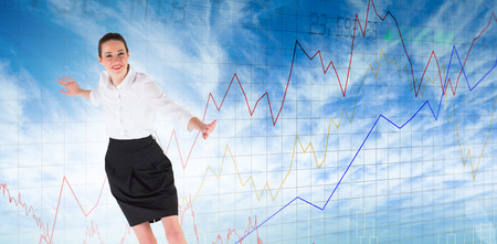 balancing act: Businesswoman performing a balancing act against stocks and shares