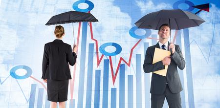 sheltering: Businessman sheltering under umbrella holding file against blue data