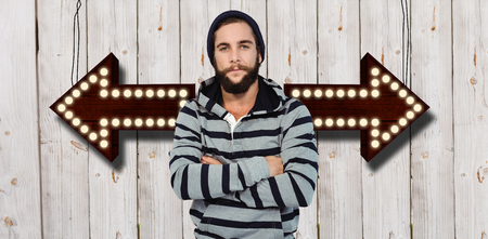 hooded shirt: Portrait of hipster with hooded shirt against wooden background Stock Photo