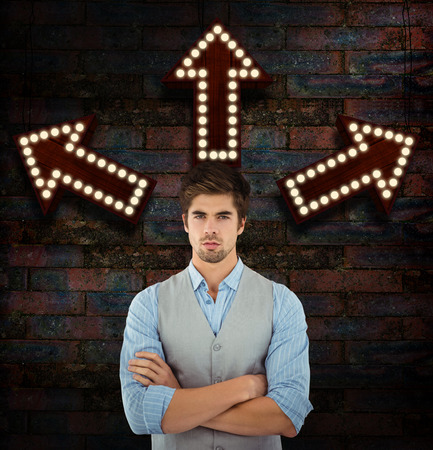 standing against: Confident businessman standing against wooden wall against brick wall Stock Photo