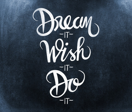Dream it wish it do it message against black background Stock Photo