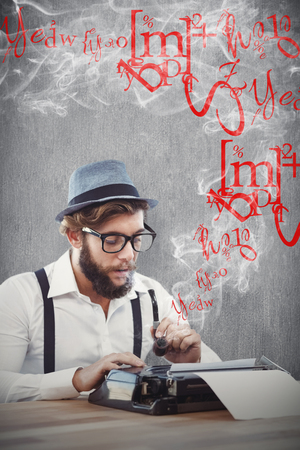 writing desk: Hipster holding smoking pipe while working on typewriter against white and grey background