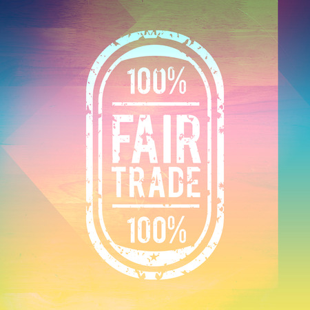 wood trade: Fair Trade graphic against colored wood