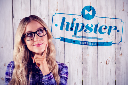 daydreaming: Gorgeous smiling blonde hipster daydreaming against wooden background Stock Photo