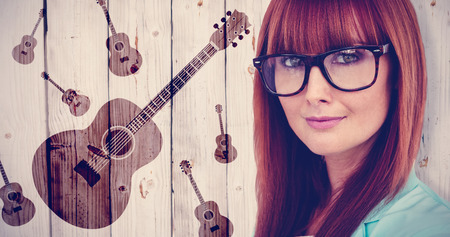 beautiful bangs: Portrait of a smiling hipster woman against wooden background Stock Photo