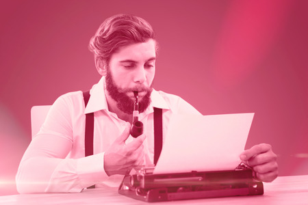 smoking pipe: Hipster with smoking pipe working on typewriter against red vignette