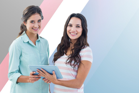 half dressed: Smiling businesswoman with tablet against colored background