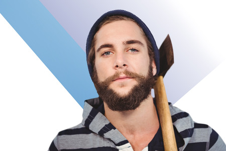 hooded shirt: Close-up portrait of hipster with hooded shirt holding axe against colored background