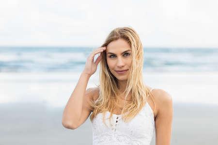 coastline: Beautiful blonde woman relaxing in the coastline