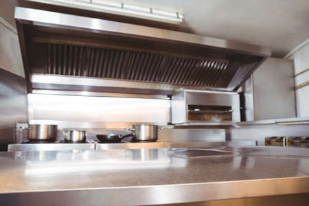 commercial kitchen: Chrome counter with copy space in commercial kitchen LANG_EVOIMAGES