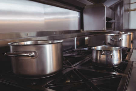 stove top: Pots and pans on stove top in commercial kitchen LANG_EVOIMAGES
