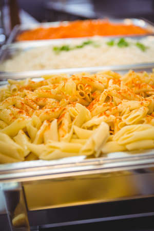 commercial kitchen: Serving dishes of potato and pasta in commercial kitchen