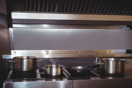 commercial kitchen: Pots and pans on stove top in commercial kitchen LANG_EVOIMAGES