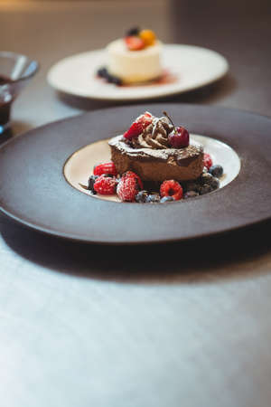 commercial kitchen: Plates of dessert at the order station in commercial kitchen