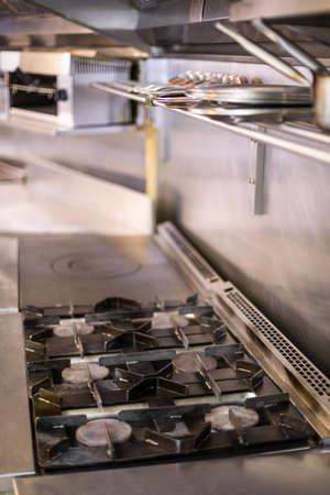 commercial kitchen: Focus on hob and stove in a commercial kitchen