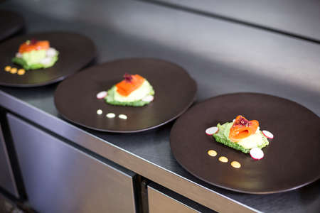 commercial kitchen: Elegant dishes on counter in a commercial kitchen