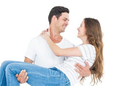carrying: Boyfriend carrying his girlfriend on white background Stock Photo
