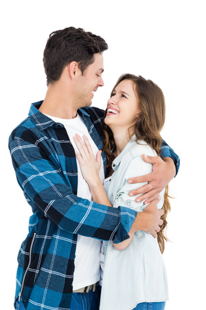 each other: Cute couple embracing and looking to each other on white background Stock Photo