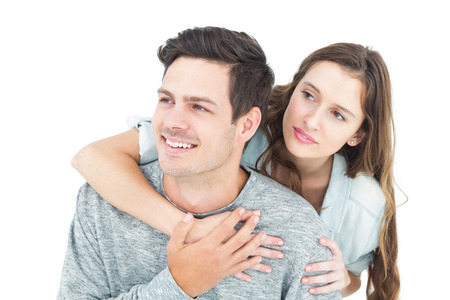 arms around: Couple embracing with arms around and looking away on white background