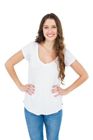 hands on hips: Smiling woman with hands on hips on white background