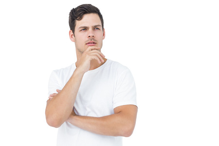 hand on the chin: Thoughtful handsome man with hand on chin on white background Stock Photo