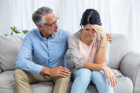 consoling: Therapist consoling a woman at home